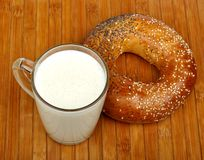 Milk and a bagel Royalty Free Stock Photos