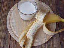 Milk and banana. Healthy Breakfast milk and a banana Stock Photo