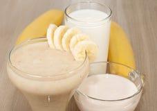 Milk-banana shake. Fruity drink with banana, milk and yogurt royalty free stock image