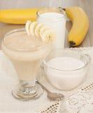 Milk-banana shake. Smoothie of banana, milk and yogurt royalty free stock photos