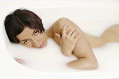 Milk bath Royalty Free Stock Image