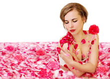 Milk bath Cleopatra. With rose petals. Isolated Royalty Free Stock Photography