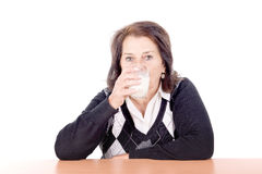 Milk. Beautiful senior woman with glass of milk isolated in white Stock Photos