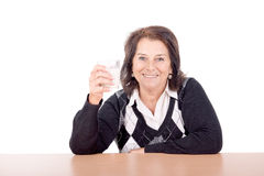 Milk. Beautiful senior woman with glass of milk isolated in white Stock Images