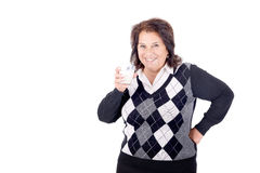 Milk. Beautiful senior woman with glass of milk isolated in white Stock Photo