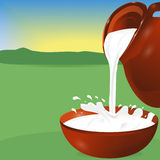Milk being poured from a jug into a bowl. Splash.  Stock Photo