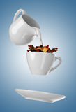Milk being poured into small cup of coffee. 3d Royalty Free Stock Images