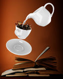 Milk being poured into small cup of coffee. 3d Stock Photo