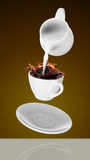 Milk being poured into small cup of coffee. 3d. Rendering Royalty Free Stock Image