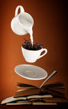 Milk being poured into small cup of coffee. 3d Royalty Free Stock Image