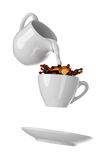 Milk being poured into small cup of coffee. Isolated white background. 3d rendering Stock Images