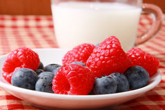 Milk and berries. Blueberries and raspberries with milk Stock Photography