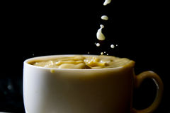 Milk and black coffee Stock Image