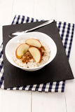 With milk boiled porridge, apple pieces, cinnamon and sugar Royalty Free Stock Images