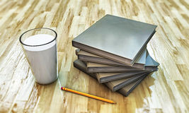 Milk and books Stock Photos