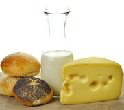 Milk bottle , cheese and fresh rolls Stock Images
