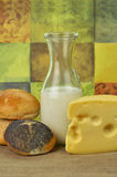 Milk bottle , cheese and fresh rolls Royalty Free Stock Photo