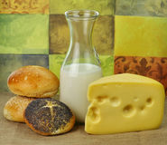 Milk bottle , cheese and fresh rolls Stock Photo