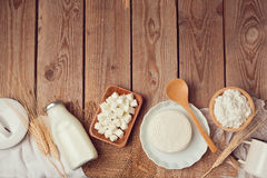 Milk bottle and cheese on wooden table. Healthy eating concept. View from above. Stock Photos