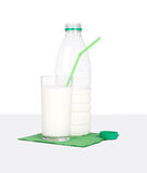Milk bottle and glass on green napkin. Royalty Free Stock Images