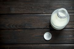 The milk in the bottle. On a wooden background stock images