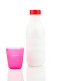 Milk bottle and plastic beaker Stock Images
