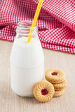 Milk bottle and strawberry jam sandwich cookies Stock Images