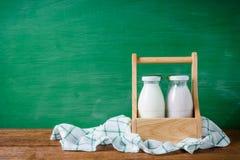 Milk bottles in the box Stock Photo