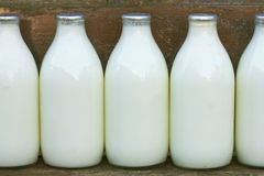 Milk bottles. Standing on a doorstep Royalty Free Stock Photos