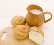 Milk and bread. Milk in a jug and bread Stock Image