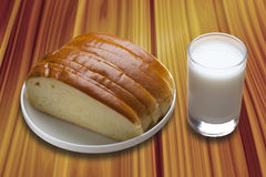 Milk and bread. On the table Stock Photography