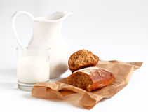 Milk and bread. On paper Royalty Free Stock Image