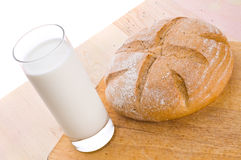 Milk and bread Stock Image