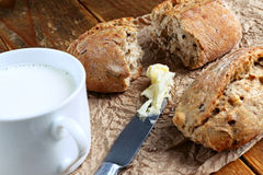 Milk and bread. Close up of healthy wholegrain crispy bread and cup of milk Stock Photos