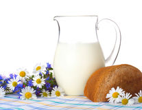 Milk, bread and field flowers Royalty Free Stock Image