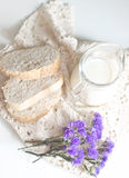 Milk, bread and flowers Stock Images
