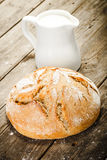 Milk and bread Stock Image