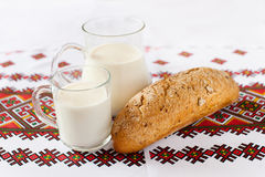 Milk and bread on national white wooden table Royalty Free Stock Photos