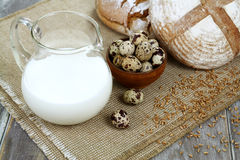 Milk, bread and quail eggs Royalty Free Stock Photography