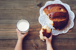 Milk and bread. On a wooden table royalty free stock photo