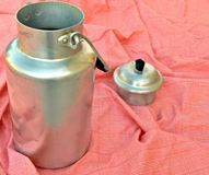 Milk, breakfast, liquid, milking, white, sweet, ta. Old milk container to put on tablecloth Stock Photo