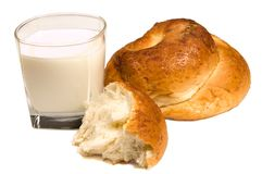 Milk and bun Royalty Free Stock Images