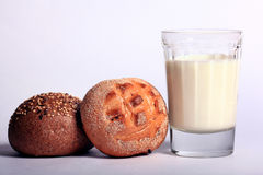 Milk and bun Stock Photos