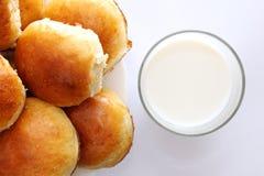 Milk and buns. On white table Stock Photos