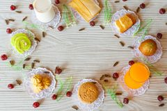 Milk Butter Bread Garlic Bread Banana Cupcake Orange Juice Cupcake Cookie Cake Roll Sunflower Seed and Gooseberry on White Wooden stock image