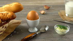 Milk, butter, cookies, egg, and fresh bread on a rustic wooden table. Countryside breakfast. stock footage