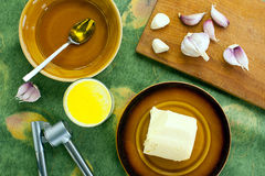 Milk with butter, garlic and honey Stock Photography