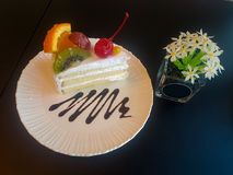 Milk cake topped with fruits. Royalty Free Stock Photography