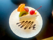 Milk cake topped with fruits. Stock Images