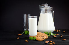 Milk and cakes with almonds and mint Royalty Free Stock Photography